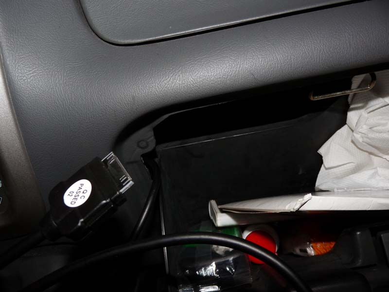 iPod cable in glove box.